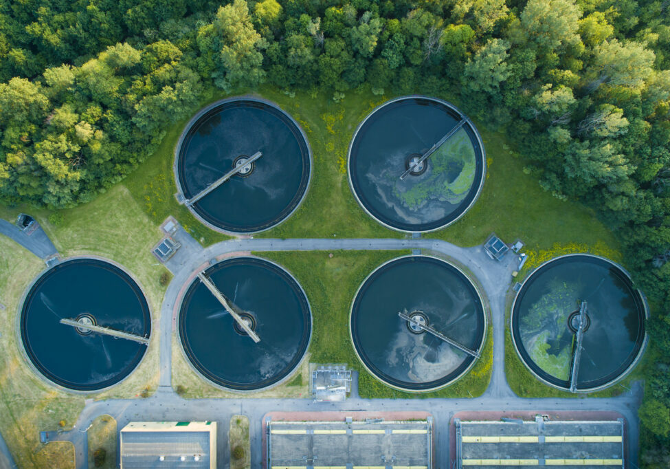 Aerial view of a city's waste management sewage and water treatment plants. Waste water purification.